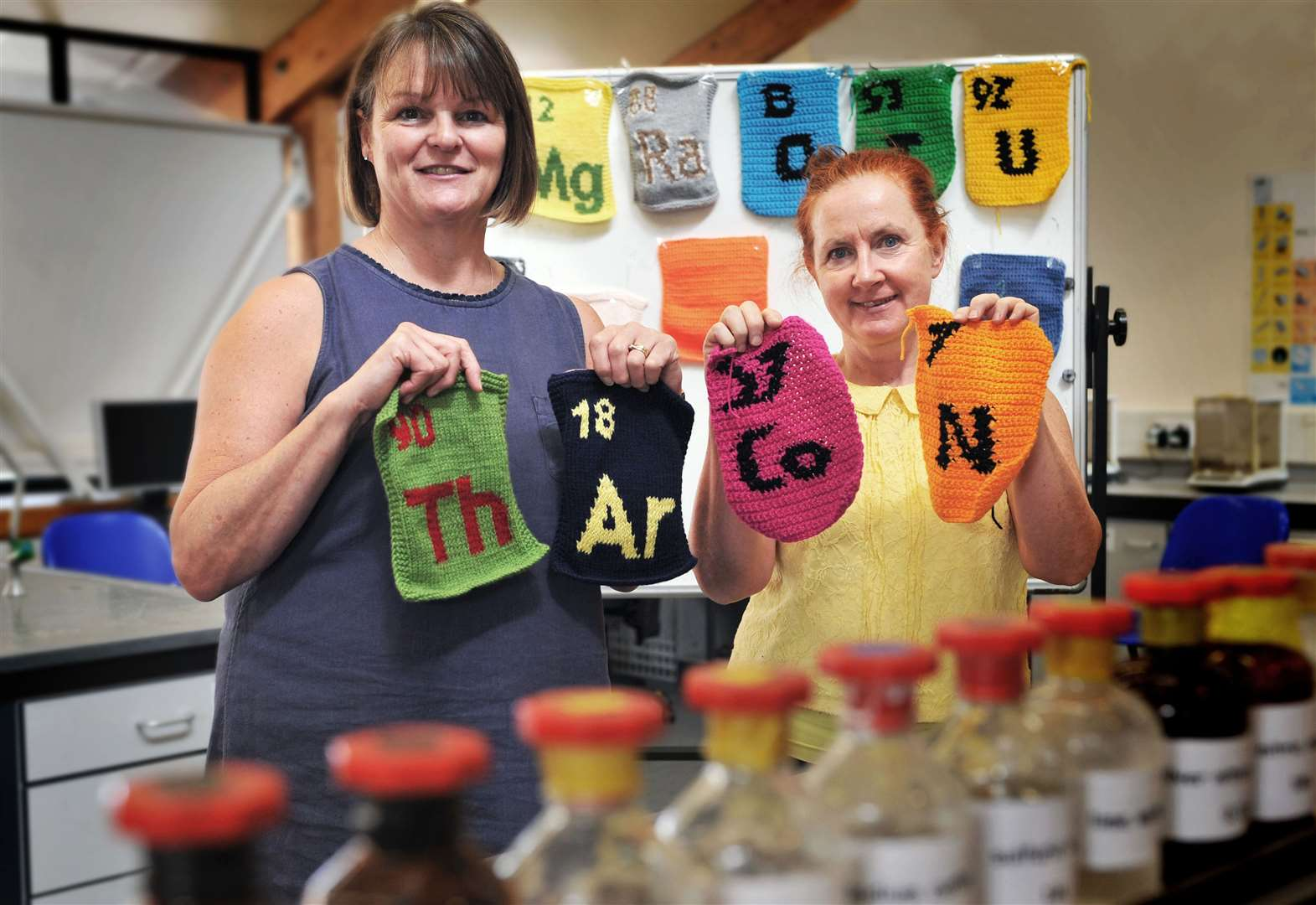 Staff at Cambridge Regional College knit periodic table