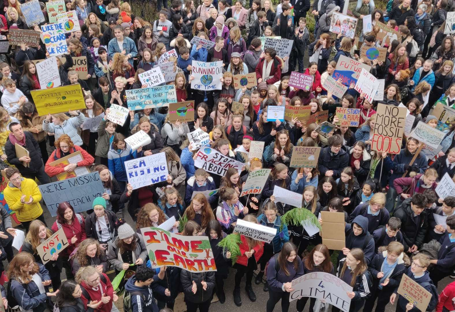 Hundreds join youth climate strike in Cambridge