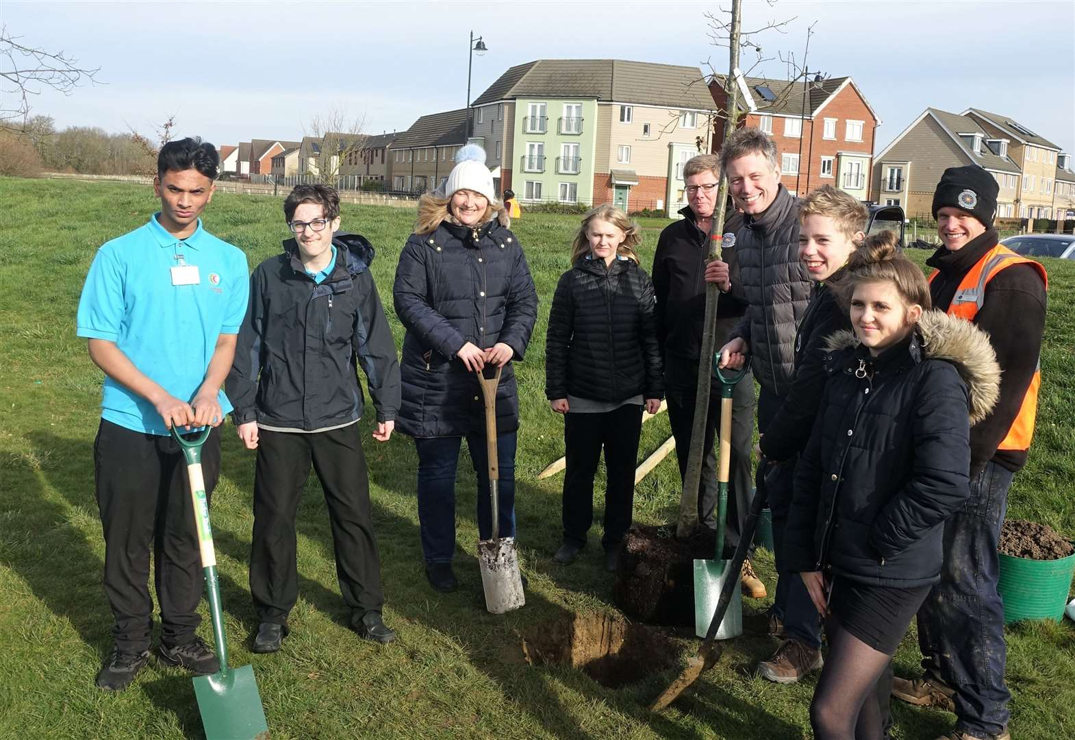 Cambourne Village College pupils and volunteers help plant hedgerow around Great Cambourne cricket pitch