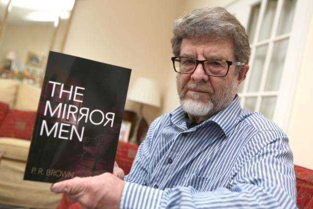 Phillip Brown with his novel, The Mirror Men. Picture : Richard Marsham