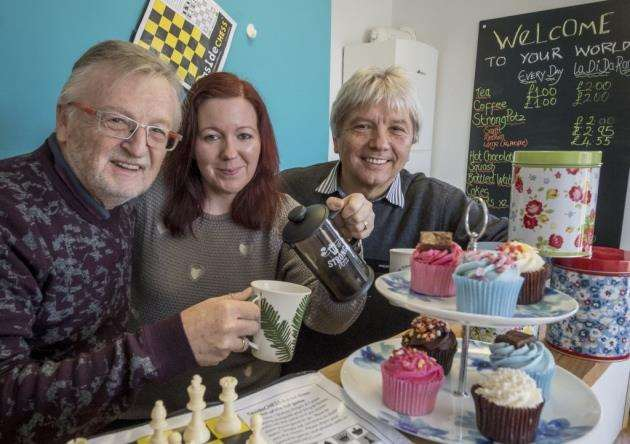 Crossways Community cafe opens at 1 Longstanton Road Oakington, from left Keith Knight enjoys a coffee served by Hanna Lumley with Ranko Pinter . Picture: Keith Heppell