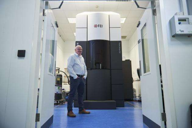 Chris Phillips, associate director of structural biology at the IMED Biotech Unit at AstraZeneca, with cryo-EM microscope