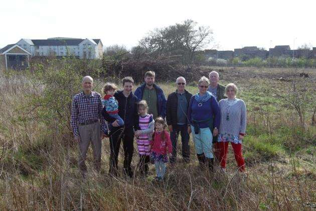 Andrew Clark, Paul Rainford with Jonah, Isme and Laila, Chris Wilson, Ian Chadwick, Kathy Males, Roy Gwinn and Xtal Gwinn, stand on the site for K1 Co Housing Community, Orchard Park. Picture: Harry Hubbard