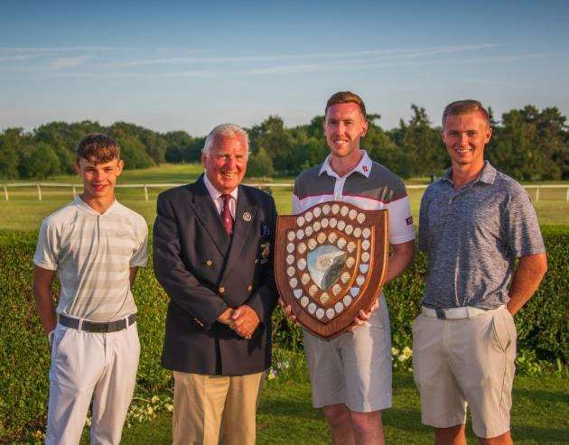 The winning Ely team of Alfie Guy-Pinkney, Luke Ryan and Ryan Woods, with county president David Orwell (second left) at the Cambridgeshire Area Golf Union County Championships. Picture: Kevin Diss Photography/kevindiss.com