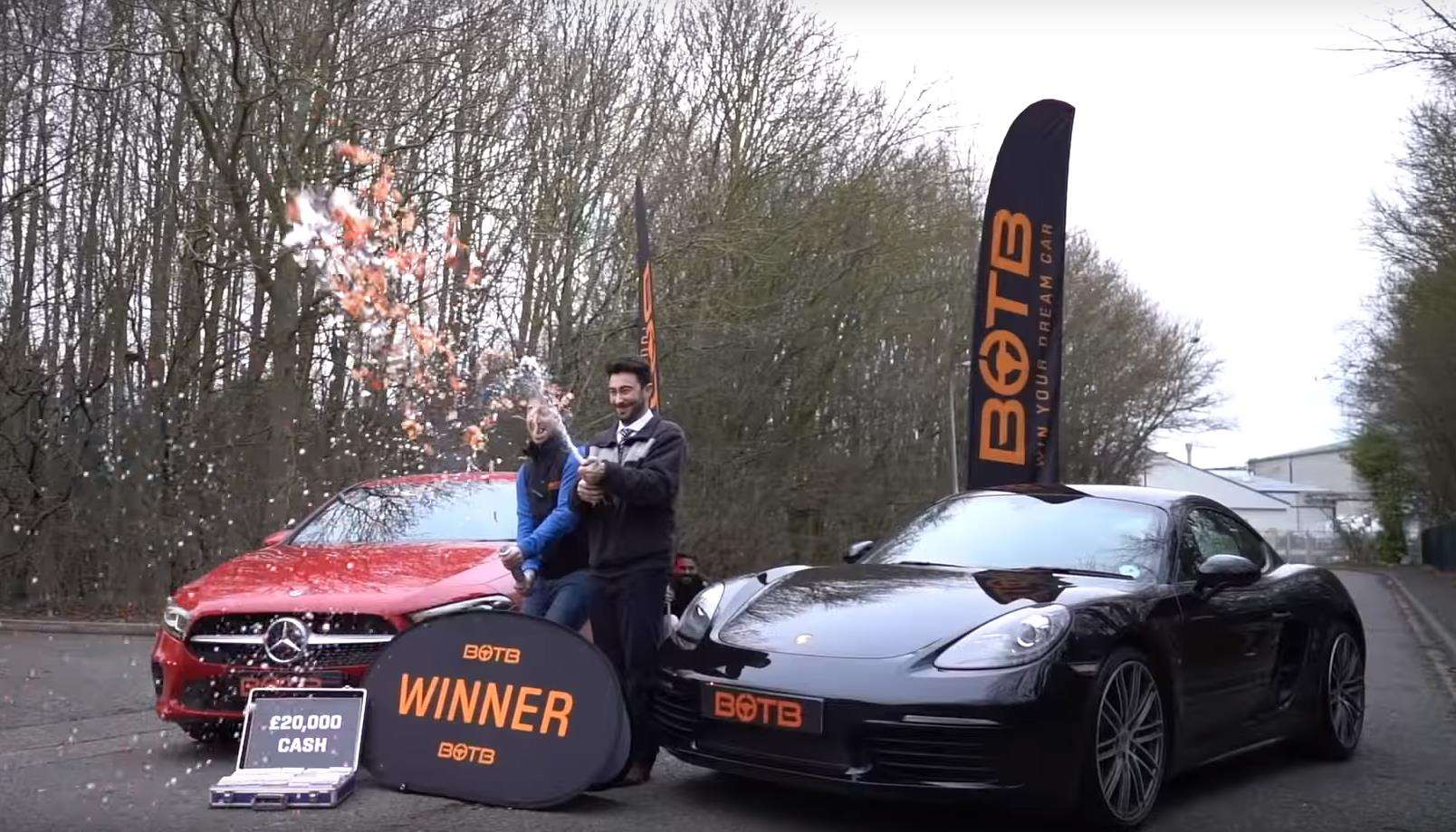 Kieran Groom, winner of two cars and £20,000 cash from BOTB, celebrates with Christian Williams