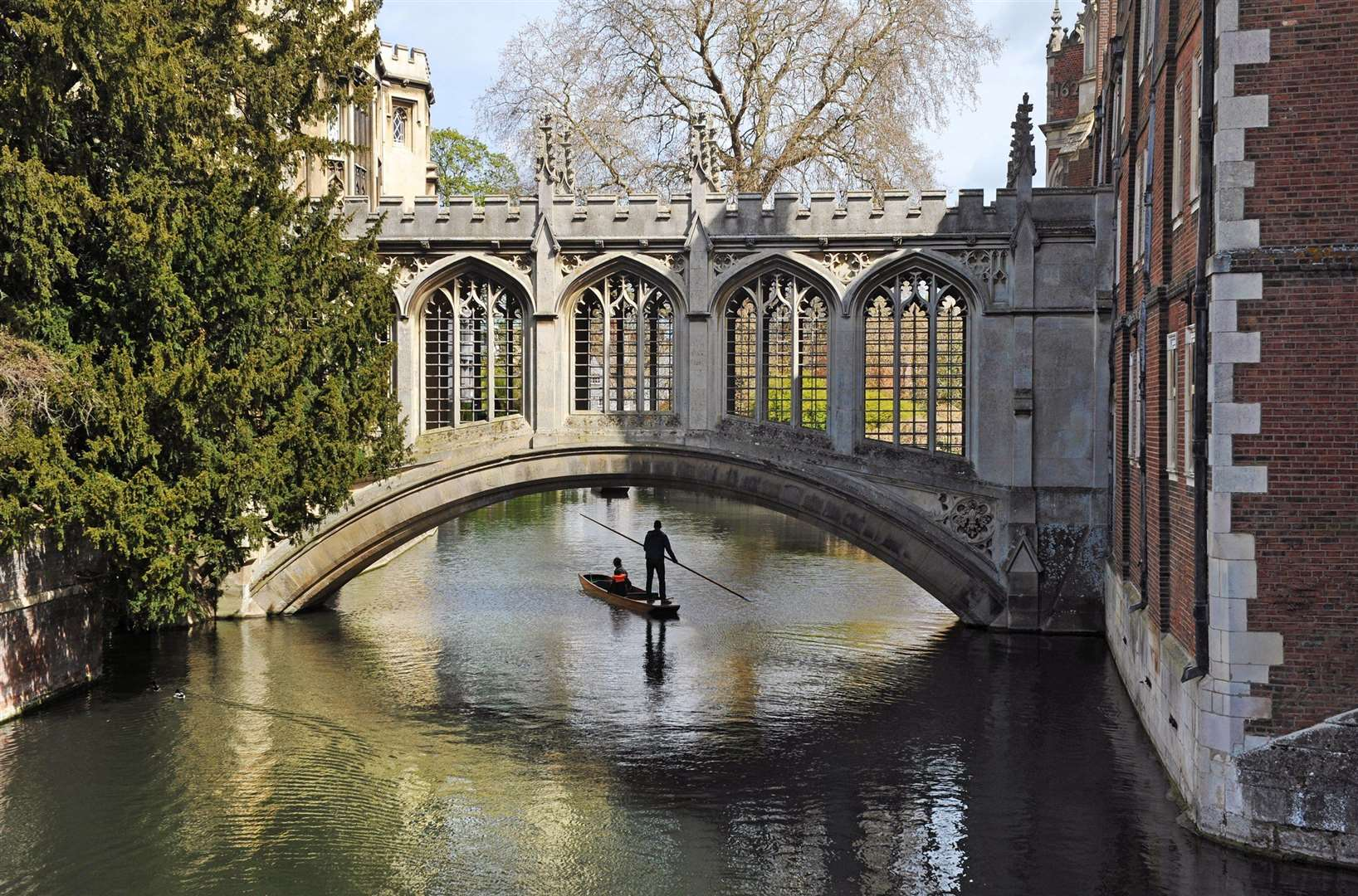 A punt on the River Cam beneath The Bridge of Sighs, St John's College, Cambridge