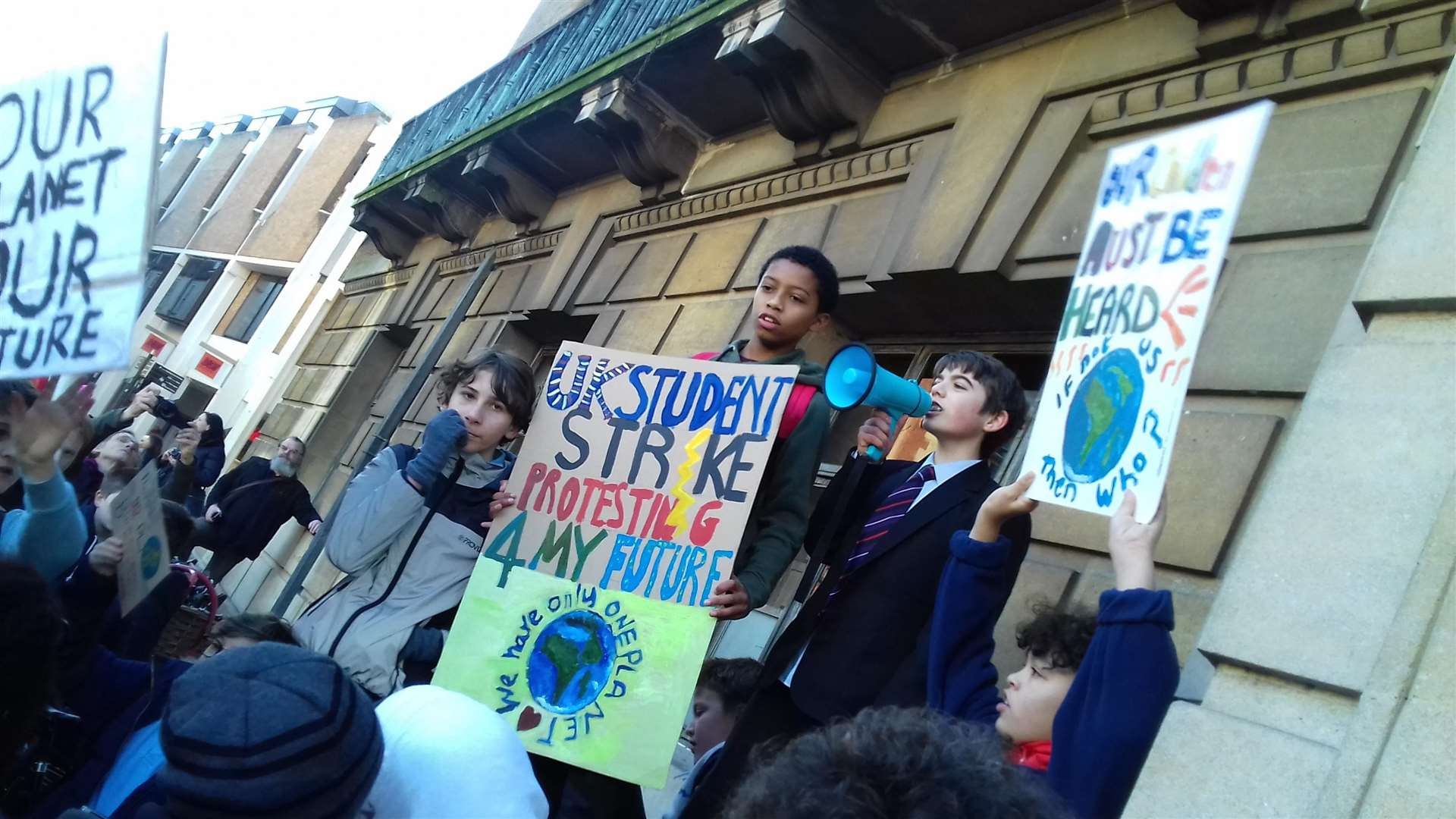 YouthStrike4Climate outside Guildhall include Shane Asante-O'Neill, 12, with placard. Picture: Mike Scialom