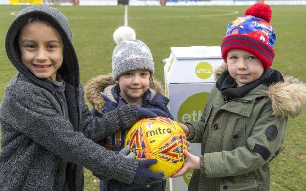 Presenting the match ball for Cambridge United v Luton were Jack Entwistle, 8, whose great-great grandfather, Private Ernest Muggleton from Grantchester, served in WWI and Lily Turpin, 4, who wore her great grandfather, Sgt Richard Turpins WWI medals. He served in the Cambridgeshire Regiment. Finley Bagnall (wearing the hat) is five. Hes the son of the Regimental Sergeant Major of the Cambridge University Officer Training Corps. Picture: Keith Heppell