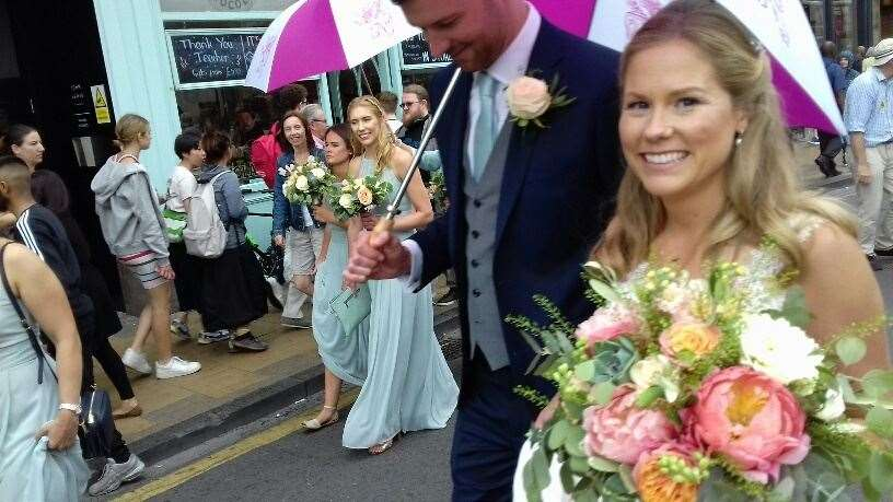 Wedding procession receive cheers as they make their way along traffic-free streets in the centre of Cambridge