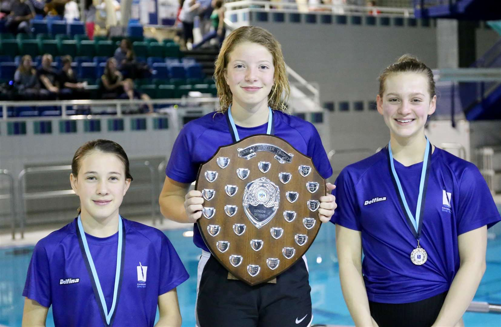 From left, Isabella Given, Frankie Webb and Elora Graham in the seniors' section of Cambridge Dive Team's Harley Winster Gala Trophy. (6371673)