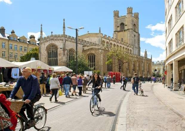 3cbd214901d09 Cambridge, England - May 28, 2015: People biking at the Market square near