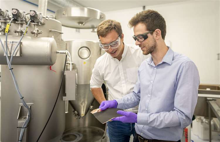 Echion Technologies co-founders Jean de la Verpilliere, CEO, and Alex Groombridge, CTO,chek the quality of their lithium battery upgrade. Picture: Keith Heppell