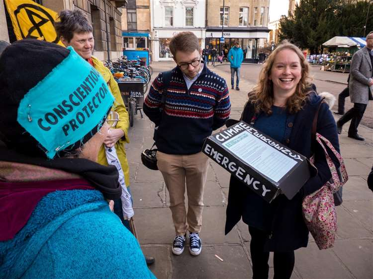 Extinction Rebellion hands in petition to council environmental officer Rosy Moore. Picture: Derek Langley