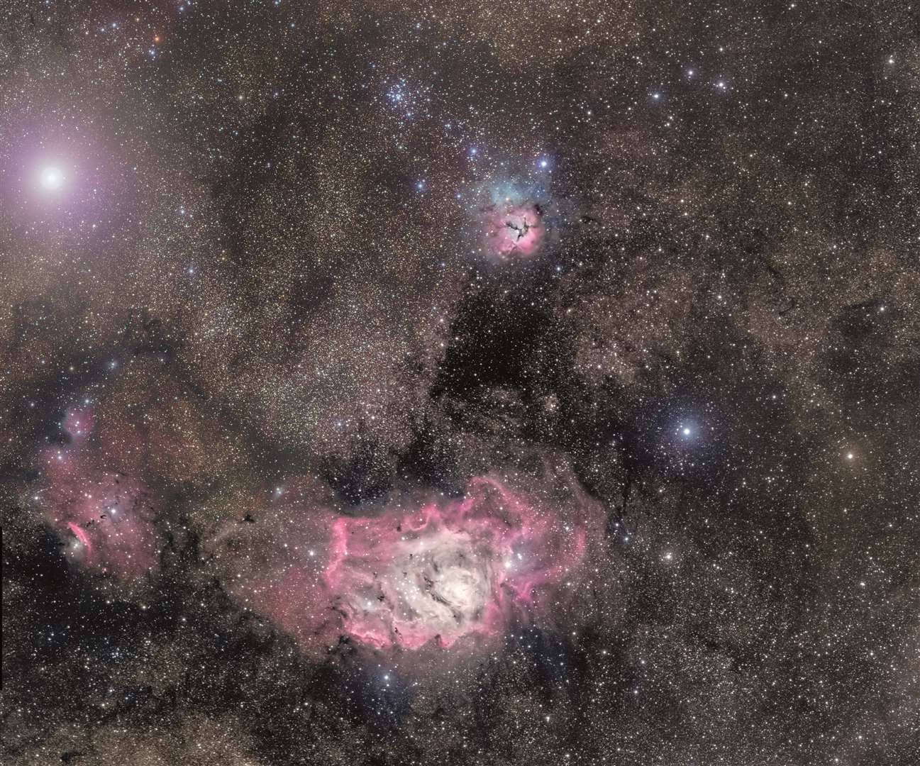 Shropshire-based Pete Williamson captured this image, which is featured in the book 2020 Stargazing. It shows the Lagoon Nebula below the Trifid Nebula, in Sagittarius. Top left is Saturn. The dark dust lanes in the nebulae are made of dust shed by old stars, which forms rocky planets. The image was captured by remote-observing with a Takahashi 106mm telescope at Siding Spring in Australia, using red, green and blue filters. Picture: Galaxy Picture Library/Pete Williamson (18337390)