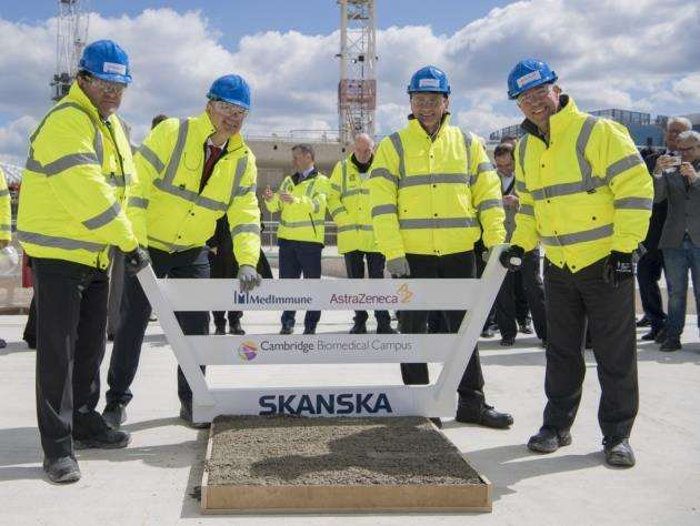 AstraZeneca is moving to a new HQ on Cambridge Biomedical Campus. At a topping out ceremony are, from left Duncan Maskell, Anders Danielsson, Pascal Soriot, and Mene Pangalos . Picture: Keith Heppell