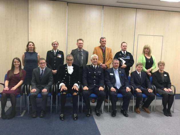 Back row, left to right: Det Ch Insp Laura Koscikiewicz, Supt Laura Hunt, DC Ralph King, DS John Yore, PC Stuart Appleton and DC Amanda Blythe. Front row, left to right: Comms assistant Laura Wilson, Mr James Richardson, High Sheriff David Arkulus, Chief Constable Alec Wood, Police and Crime Commissioner Jason Ablewhite, Master Aaron Spencer and Insp Lucy MasonThomson.