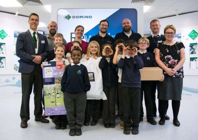 Children and teachers from Bar Hill Community Primary School receive scientific gifts from Domino, sourced by Crosland Communications Ltd