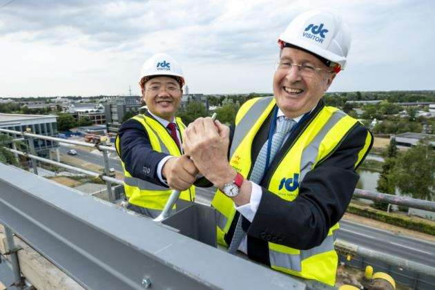 Trinity College master Sir Gregory Winter with Tus-Holdings chairman Jiwu Wang at the topping-out ceremony for the new Bio-Innovation Centre on Cambridge Science Park, owned by Trinity College. Picture: Keith Heppell