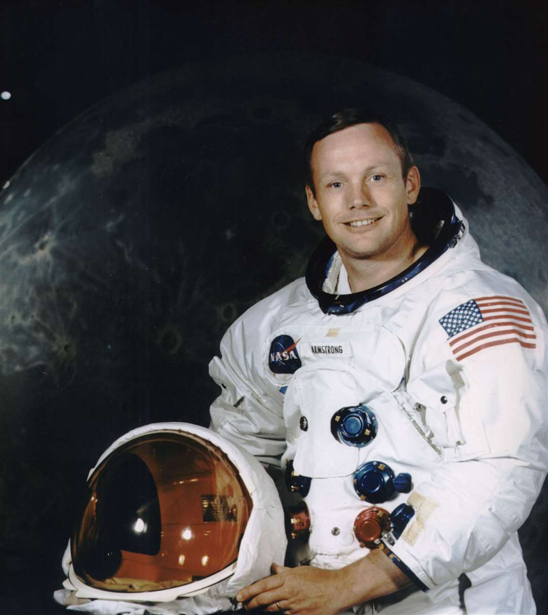 Neil Armstrong, donned in his space suit, poses for his official Apollo 11 portrait. Armstrong began his flight career as a naval aviator. He flew 78 combat missions during the Korean War. Armstrong joined the NASA predecessor, NACA (National Advisory Committee for Aeronautics), as a research pilot at the Lewis Laboratory in Cleveland and later transferred to the NACA High Speed Flight Station at Edwards AFB, California. He was a project pilot on many pioneering high speed aircraft, including the 4,000 mph X-15. He has flown over 200 different models of aircraft, including jets, rockets, helicopters, and gliders. In 1962, Armstrong was transferred to astronaut status. He served as command pilot for the Gemini 8 mission, launched March 16, 1966, and performed the first successful docking of two vehicles in space. In 1969, Armstrong was commander of Apollo 11, the first manned lunar landing mission, and gained the distinction of being the first man to land a craft on the Moon and the first man to step on its surface. Armstrong subsequently held the position of Deputy Associate Administrator for Aeronautics, NASA Headquarters Office of Advanced Research and Technology, from 1970 to 1971. He resigned from NASA in 1971. Picture: NASA (14042147)