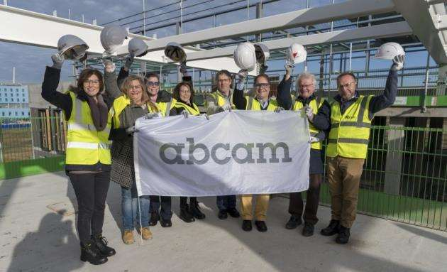 Abcams team with developers at the topping out of its new HQ on the Cambridge Biomedical Campus. Picture: Keith Heppell