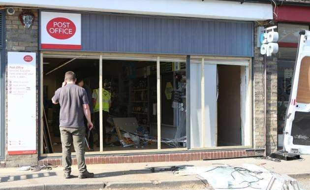 The clean up begins after another Ram-Raid at the Co-op store in Fulbourn. Picture - Richard Marsham
