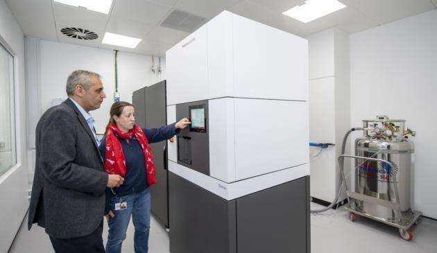 Harren Jhoti, CEO of Astex, with the new cryo-EM machine, the first of its kind in the world. Picture: Keith Heppell