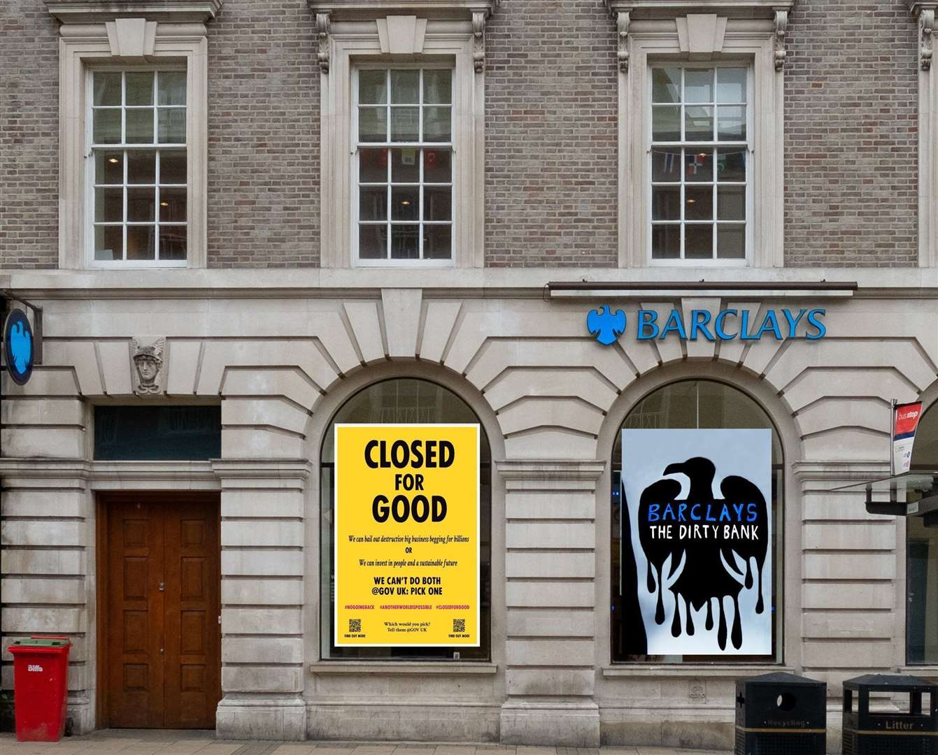 Extinction Rebellion action sees windows of Barclays bank on St Andrew's Street covered with placards