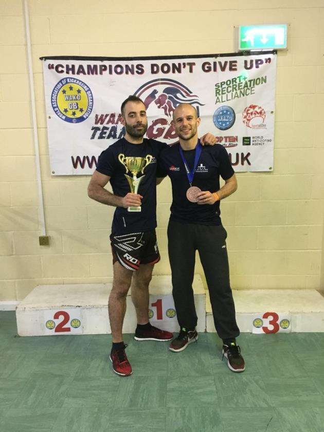 Bruno Vincente and Ricardo Miragaia after winning medals at the British Kickboxing Championships.