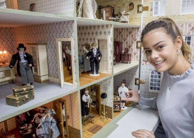 Dolls House which has been given to ACT at Addenbrookes to raise funds, here receptionist Miss Cambridgeshire Amy Johnson takes a look inside. Picture: Keith Heppell