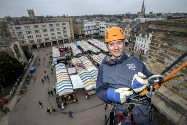 Cambridge Independent editor Paul Brackley begins his abseil in aid of the Rapid Scan Appeal. Picture: Keith Heppell