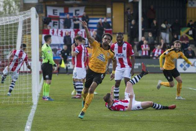 Leon Legge scores the winner for Cambridge United against Exeter City. Picture: Keith Heppell