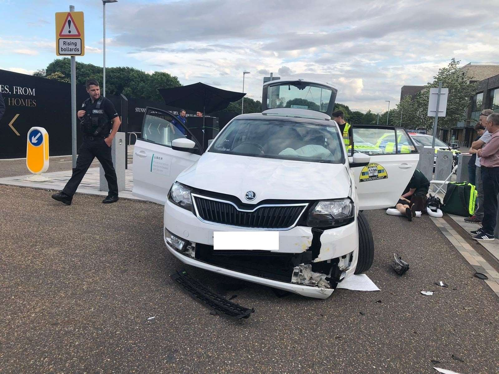 Police attend the scene of a Uber car collision with a bollard on Eddington Avenue in Cambridge. Pic: Errol Ballantyne (13730930)
