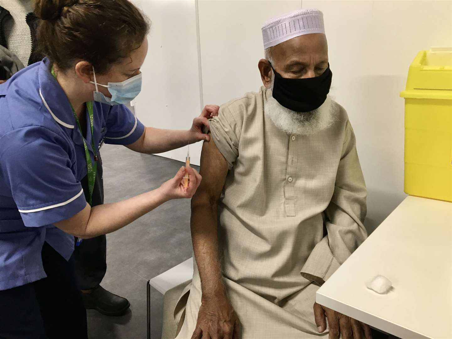 Muhammed Tuta Miah receives the Covid-19 vaccine at The Grafton. Picture: Cambridgeshire Community Services NHS Trust