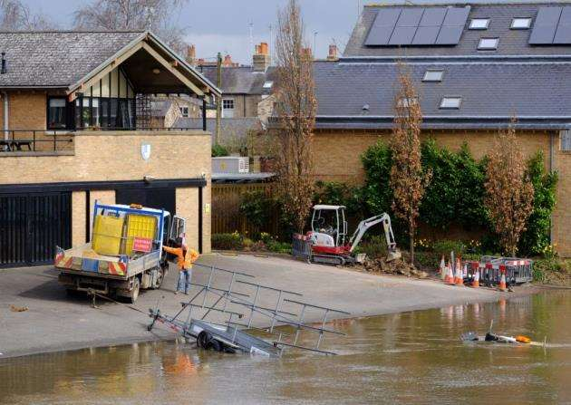 A workmans van has fallen into the River Cam at Queens Boathouse. Pic - Richard Marsham