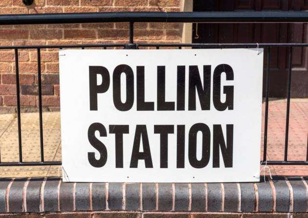 A Polling Station sign outside village hall during a UK election.