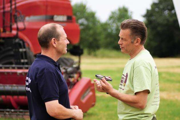 Chris Packham, right, talks to Martin Lines at Papley Grove Farm in Eltisley. Picture: Paul Brackley
