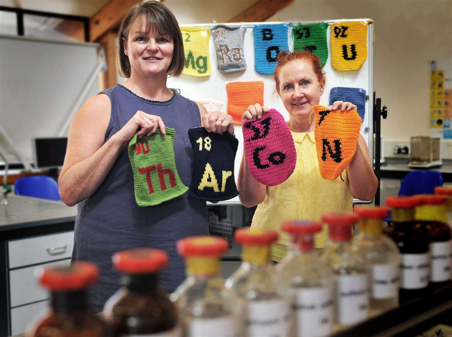 From left, Judith Ward and Ursula Lowe with the knitted Periodic Table
