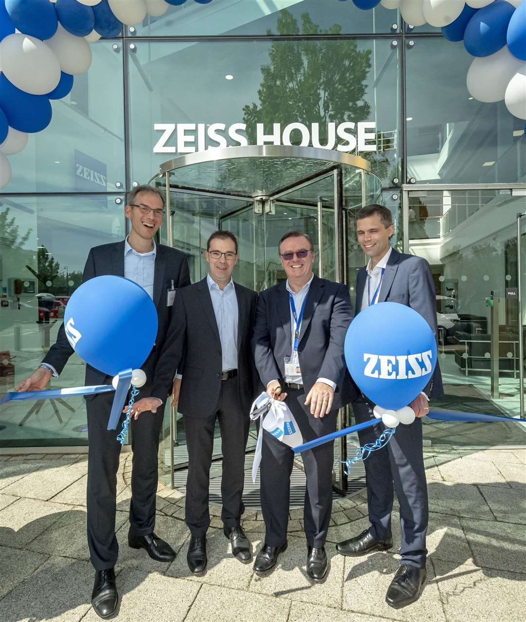 Carl ZEISS official opening of their new offices, ZEISS Hous,e 1030 Cambourne Business Park, Cambourne, from left Dr Markus Weber, Paul Adderley, Dr Jochen Peter and . Picture: Keith Heppell. (15077028)