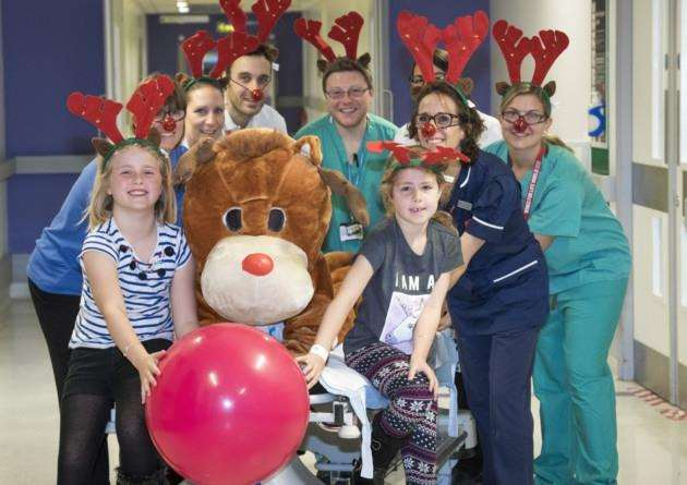Addenbrookes Charitable Trust are hoping to get 250 people to sign up to their Rudolph Run this year to help celebrate the anniversary. Here patients, staff and ACT Mascot join in the fun in the hospital. Picture: Keith Heppell