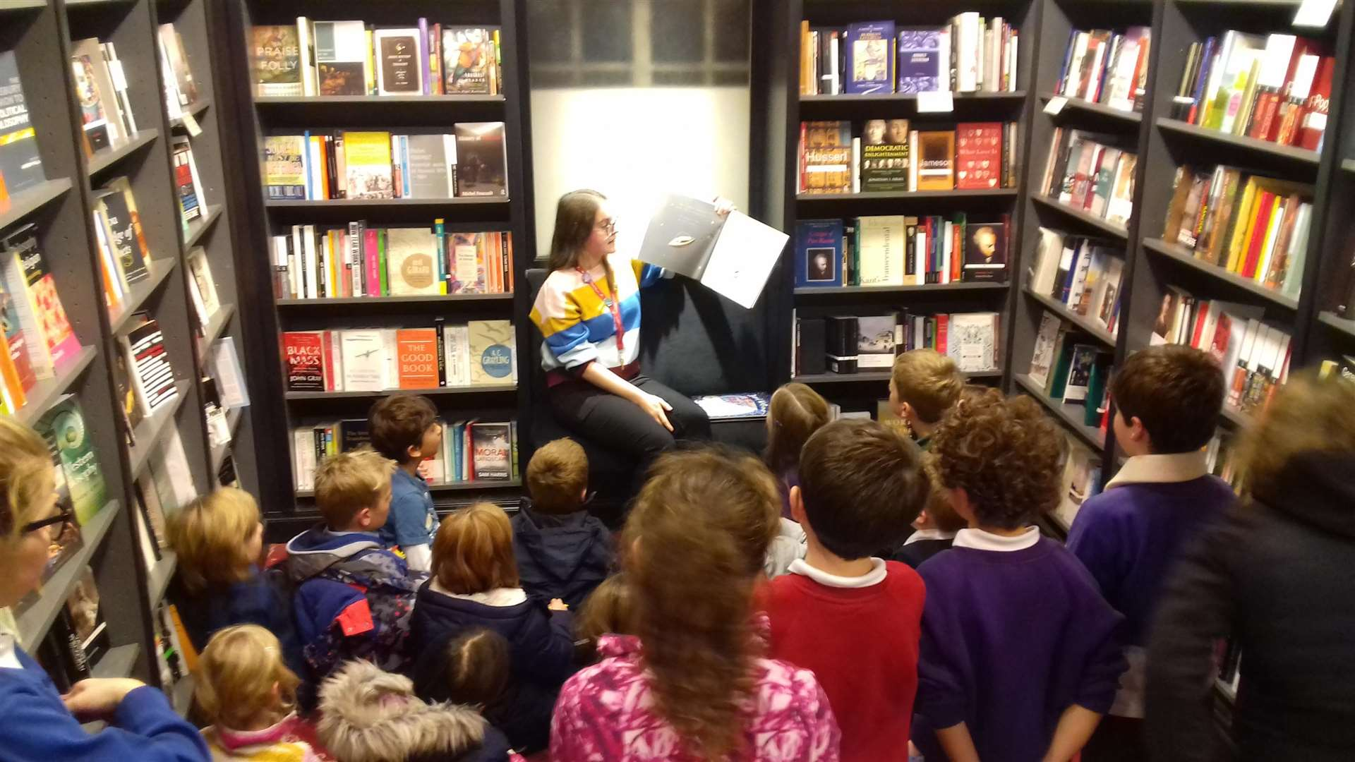 Younger customers listen to a reading from Tim Peake's book (5689900)