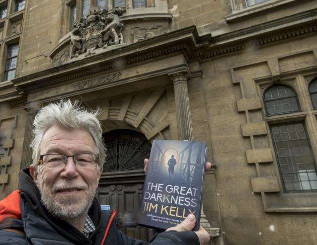 Author Jim Kelly outside the old Borough Police Staton on Trumpington Street where some of his new series is based. Picture: Keith Heppell