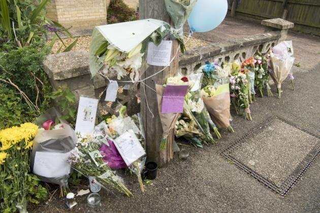 Floral tributes following the murder of James Cromwell in Cambridge