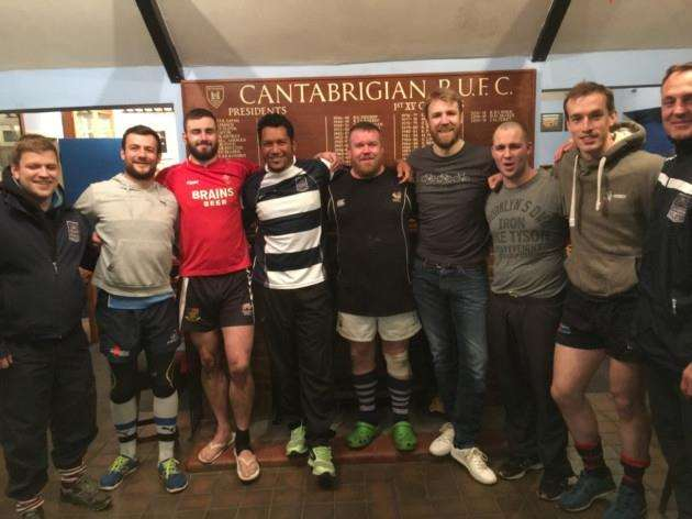 Fijis Nicky Little with members of Cantabs Rugby Club.