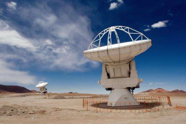 Two of the Atacama Large Millimeter/submillimeter Array (ALMA) 12-metre antennas gaze at the sky at the observatorys Array Operations Site (AOS) on the Chajnantor plateau at an altitude of 5,000 metres in the Chilean Andes. Picture: Iztok Boncina/ESO - http://www.eso.org/public/images/potw1040a/