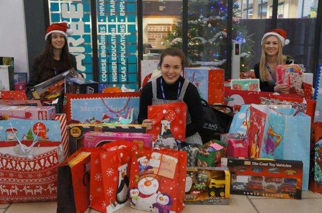 Cambridge Regional College staff Aimee Sibley Wootton, Bethany Chapman and Hannah Harland with some of the presents collected for children in care