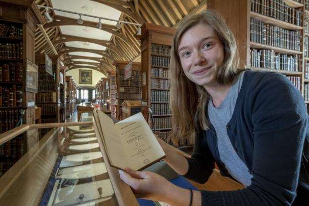Christs College librarian Hannah Goodsell with the exhibition called The art of disruption, society and the supernatural inspired by the 200th anniversary of Mary Shelleys Frankenstein. Picture: Keith Heppell