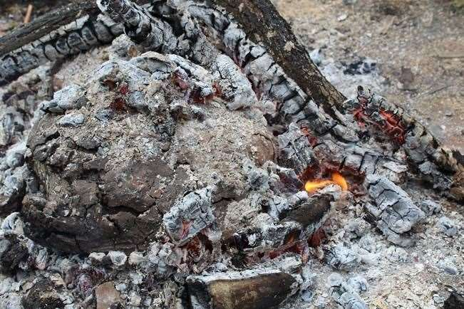 Cover lamb in clay and cook it in the fire for a festive meal. (43512751)