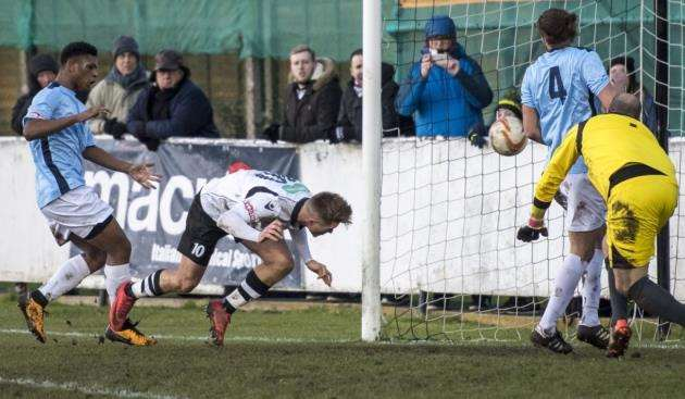 Ryan Sharman scores Cambridge Citys second goal against Axbridge. Picture: Keith Heppell