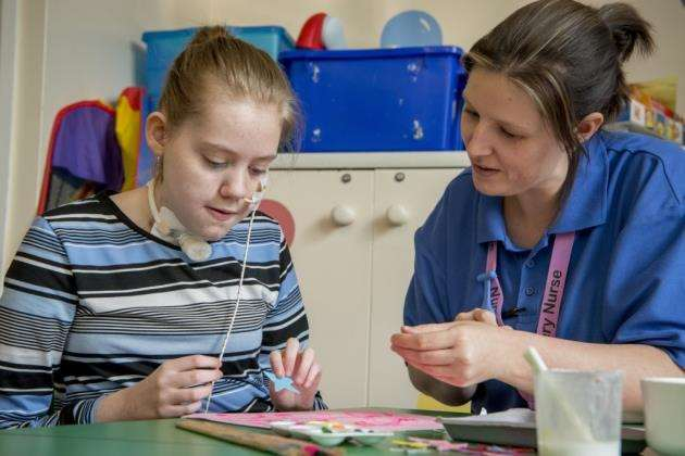Addenbrookes Hospital, Hills Rd, Cambridge, play specialists, Emma Meade with Elizabeth Fyfe 14. Picture: Keith Heppell