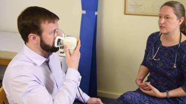 Owlstone Medicals ReCIVA Breath Sampler being used to collect a breath sample in a GP surgery